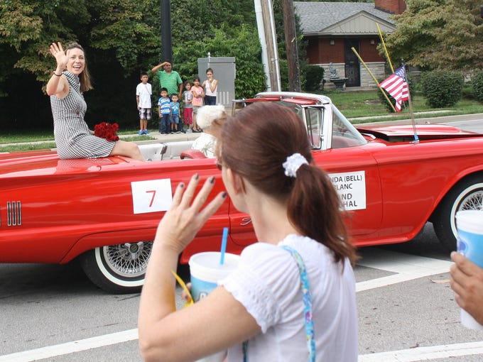 Parade Grand Marshall Amanda Bell LeBlanc waves to the crowd during the parade, a part of  ClarkFEST in Clarksville on Monday.  (By Jenna Esarey, special to The Courier-Journal)  September 1, 2014
