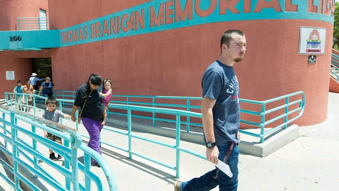 Chris Huckabay, of Las Cruces, and others enter and exit the Thomas Branigan Memorial Library on Monday, June 10, 2017. The library will be part of a $148 million expansion project that city councilors OK'd last month.