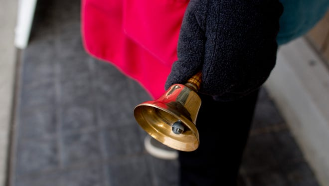 Salvation Army volunteer James Lloyd, of Port Huron, rings a bell near a donation kettle