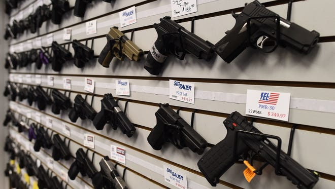 Handguns are shown for sale.