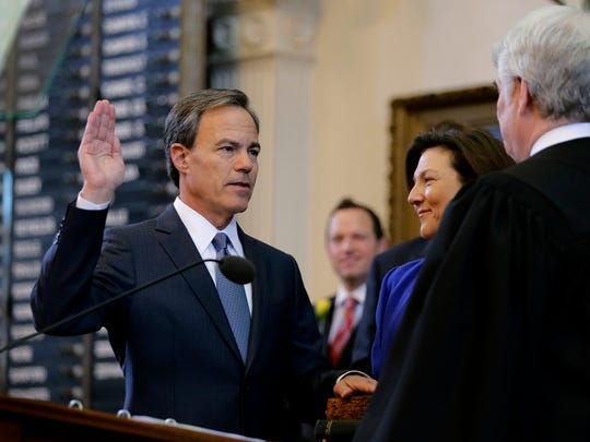 Texas state Rep. Joe Straus, R-San Antonio, left, is sworn in as Speaker of the House on the opening day of the 2015 Legislative session, Tuesday, Jan. 13, 2015, in Austin, Texas. (AP Photo/Eric Gay)