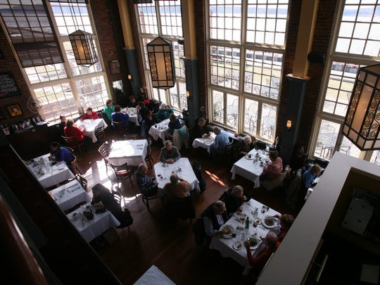 The dining area, with large picture windows, at Red