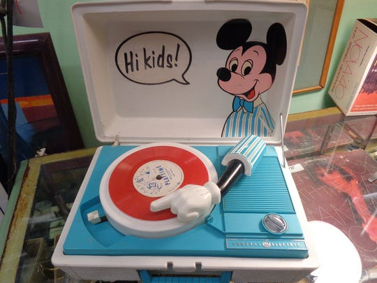 <137>This Mickey Mouse phonograph is $75 at Antique Trove, 2020 N. Scottsdale Rd.<137>