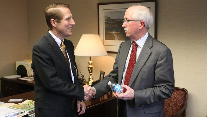Rochester General Hospital president and CEO Mark Clement, left, and Unity president  and CEO Warren Hern in 2014, when their systems merged. Tax forms from 2014 reported the compensation each received.