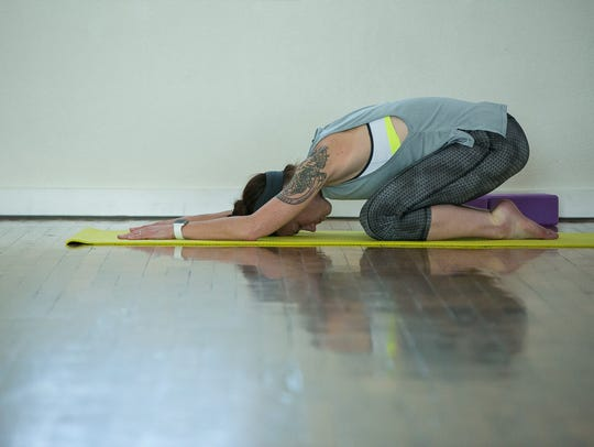Becky Graham, of Las Cruces, practices yoga at Downtown