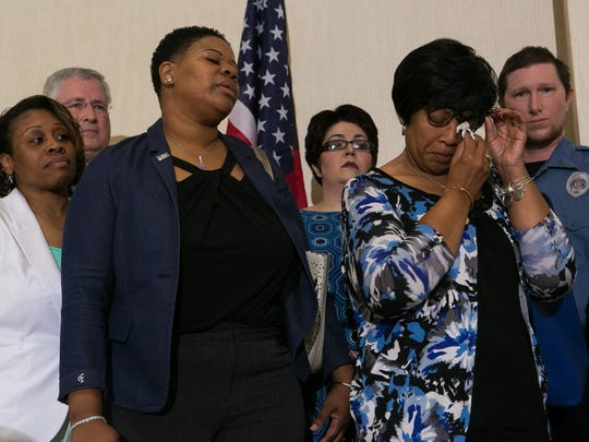 Family members of slain Lt. Steven Floyd Sr. stand