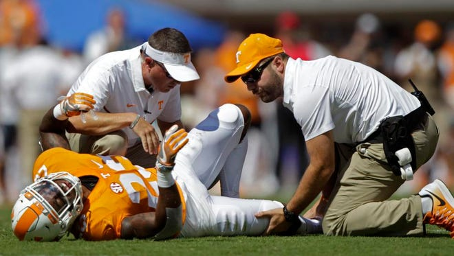 Tennessee defensive back Cameron Sutton is attended to after being injured in the first half against Ohio on Sept. 17, 2016.