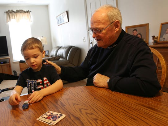 Werner Kleemann and his grandson Cole Kleemann play with Hot Wheels and look at hockey cards. Werner is a Section V Hall of Fame football coach battling a rare form of leukemia that requires blood transfusions. His former players and the Rush-Henrietta school community organized a blood drive in 2016.