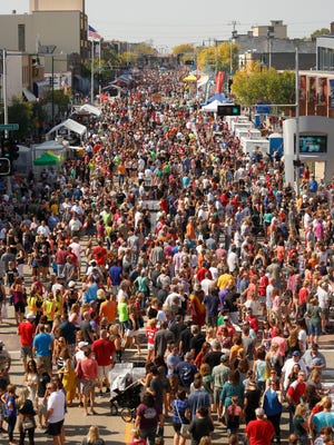 Thousands pack College Avenue during Octoberfest 2014 in downtown Appleton.
