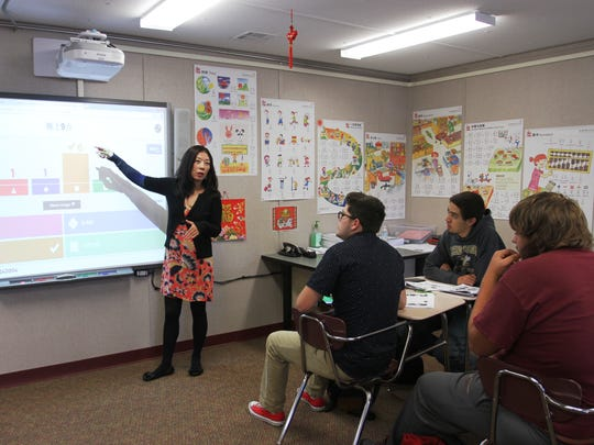 Licking Heights Local Schools' has expanded its Mandarin Chinese program in an effort to modernize its foreign language department. Here, Jane Liu, a Mandarin Chinese teacher at the high school, works with one of her classes on a recent weekday.
