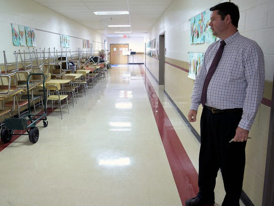 Page Middle School principal Dr. Eric Lifsey shows