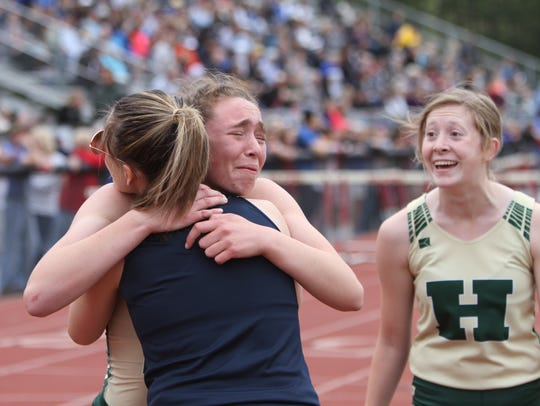 Howell's Emily Endebrock (left, facing camera) is overcome
