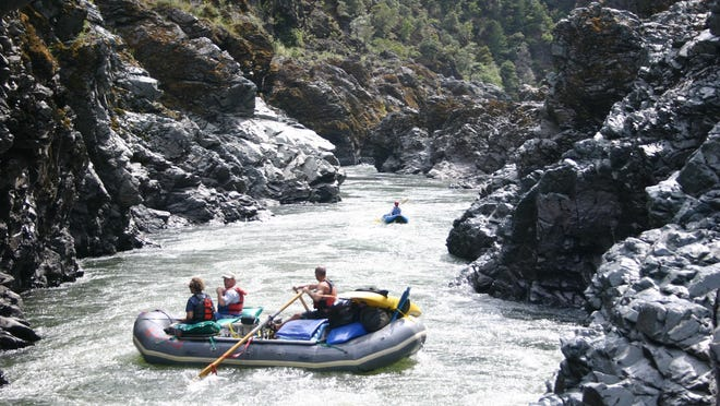 A raft heads into Mule Creek Canyon in the wild section of the Rogue River in Southern Oregon.