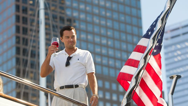 """This image released by Paramount Pictures shows Leonardo DiCaprio as Jordan Belfort in """"The Wolf of Wall Street."""" (AP Photo/Paramount Pictures, Mary Cybulski) ORG XMIT: NYET575"""