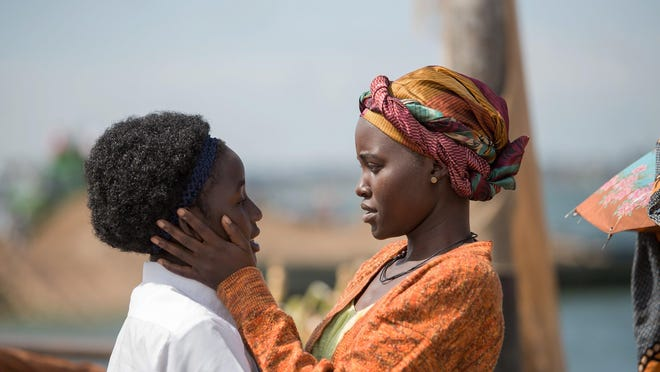 """Lupita Nyong'o, right, and Madina Nalwanga star in the movie """"Queen of Katwe,"""" which is based on a true story about a 10-year-old chess prodigy."""
