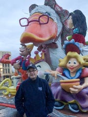 Nolan Finley poses with Mother Goose before Thursday's Thanksgiving Day Parade.