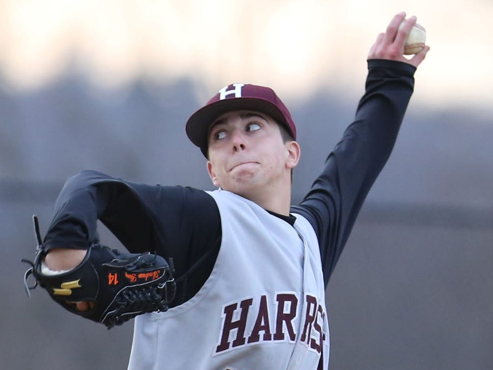 Harrison's Andrew Gurgitano pitches during a varsity baseball game against Tappan Zee at Harrison High School April 1, 2014. Gurgitano's teammates are remembering him with tributes this season.