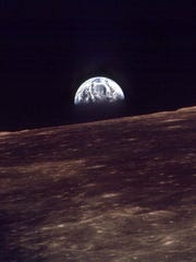 The earth rises over the horizon of the moon in this Dec. 24, 1968, photo taken by the astronauts on Apollo 8.