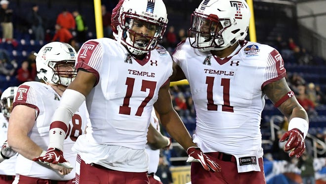 Temple players celebrate a touchdown at the Military Bowl in December. Temple will play Villanova on Sept. 9 and the Courier-Post is giving away tickets to the game.
