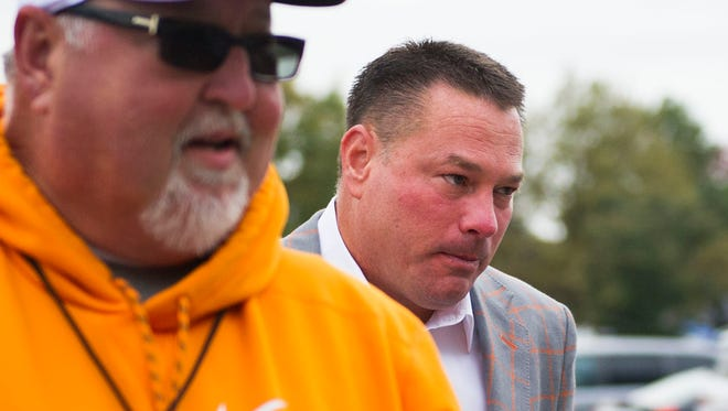 Tennessee Head Coach Butch Jones walks off the team bus towards the stadium before the Tennessee vs. Kentucky game at Kroger Field in Lexington, Kentucky Saturday, Oct. 28, 2017.