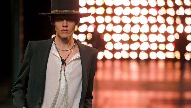A model wears a creation by French-born designer Hedi Slimane for Saint Laurent men?s Spring-Summer 2015 fashion collection, presented in Paris, Sunday, June 29.