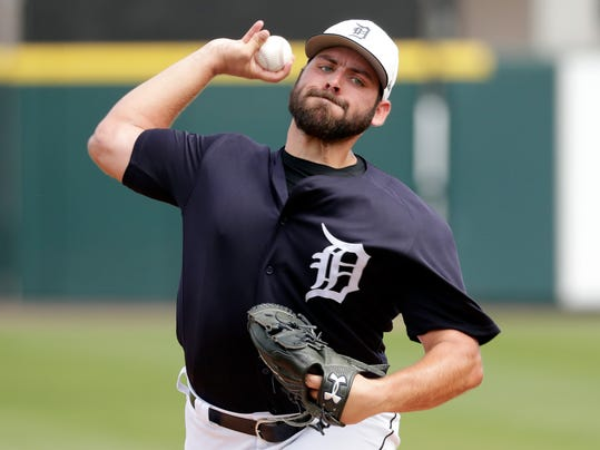 FILE - In this March 19, 2018, file photo, Detroit Tigers starter Michael Fulmer throws during the first inning of the team's spring training baseball game against the Baltimore Orioles in Lakeland, Fla. Fulmer, the 2016 American League Rookie of the Year, is 25, and the closest thing the team has to a young star. (AP Photo/John Raoux, File)