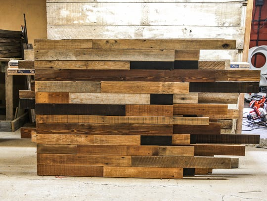 Reclaimed barn wood is constructed into a kit for buyers