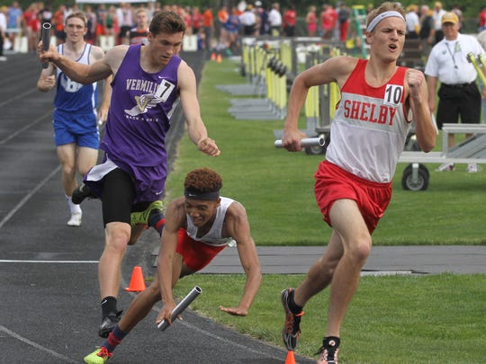 Shelby's Tyler Green charges ahead in the 4x800-meter relay during the 2016 Division II Track and Filed Regional Championships at Lexington High School.