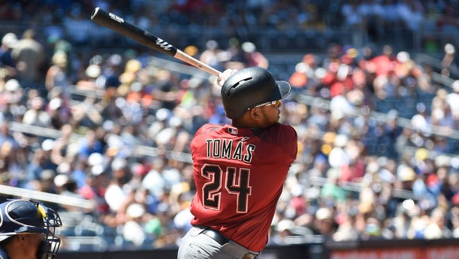 SAN DIEGO, CALIFORNIA - APRIL 17:  Yasmany Tomas #24 of the Arizona Diamondbacks hits a two-run home run during the first inning of a baseball game against the San Diego Padres at PETCO Park on April 17, 2016 in San Diego, California.