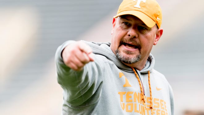 Tennessee defensive coordinator Kevin Sherrer calls out during spring practice at Neyland Stadium in Knoxville on Saturday.