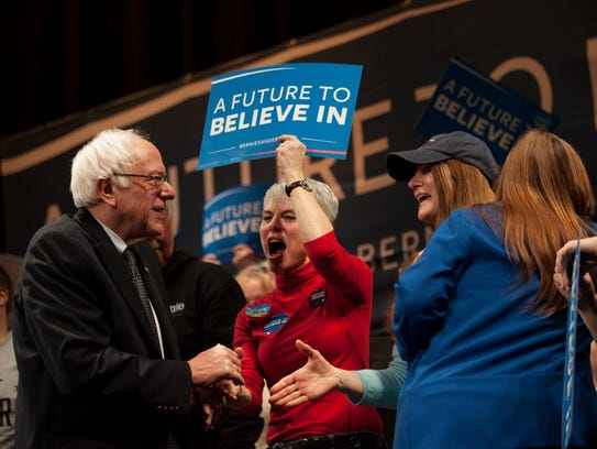 Bernie Sanders shakes hands with supporters after speaking
