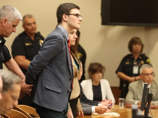 Alex Rideout is handcuffed after being found guilty