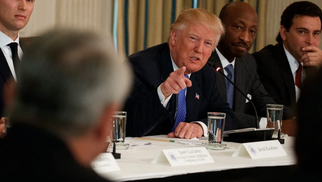 President Donald Trump speaks during a meeting with manufacturing executives at the White House in Washington, Thursday, Feb. 23, 2017. From left are, White House Senior Adviser Jared Kushner, Trump, Merck CEO Kenneth Frazier, and Ford CEO Mark Fields.