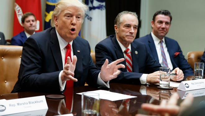 In this Feb. 16, 2017 file photo, President Donald Trump, accompanied by Rep. Chris Collins, R-N.Y., speaks in the Roosevelt Room of the White House in Washington. House Republican leaders want to shift more than $2 billion in Medicaid costs from upstate counties to the New York State government. The provision would help mostly Republican-controlled counties that have struggled to subsidize Medicaid payments for the poor. New York City wouldn't get the same relief.