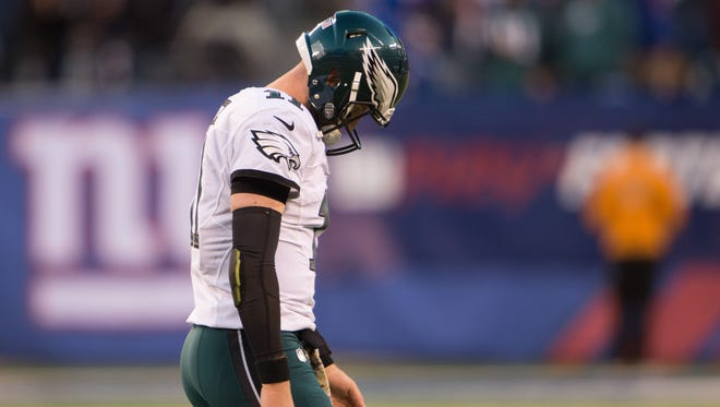 Nov 6, 2016; East Rutherford, NJ, USA;  Philadelphia Eagles quarterback Carson Wentz (11) walks off the field during the second half against the New York Giants at MetLife Stadium. The Giants defeated the Eagles 28-23. Mandatory Credit: William Hauser-USA TODAY Sports