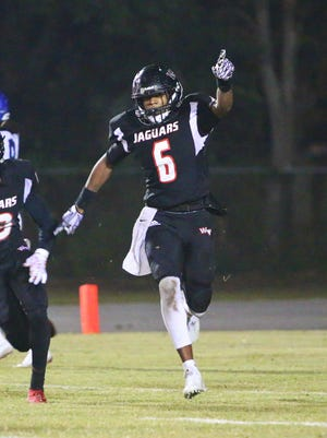 West Florida High's Keyon Helton celebrates an interception against Jacksonville Trinity Christian on Friday night in the Region I-5A semifinals.