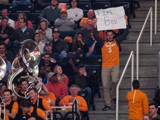 "A fan carries a ""FIRE BEV"" sign during Tennessee's"