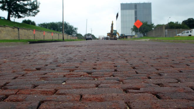 Harrison Street is seen closed off between Clinton and Dubuque streets on June 22, 2015. The bricks on the street will be salvaged to repair other brick streets around town.
