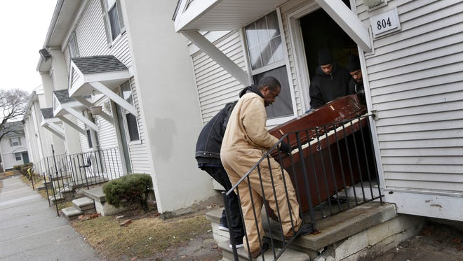 The Detroit apartment where the bodies of Stoni Blair and Stephen Berry were found dead in a deep freezer is cleaned at the Martin Luther King Apartments on Tuesday, March 31, 2015.