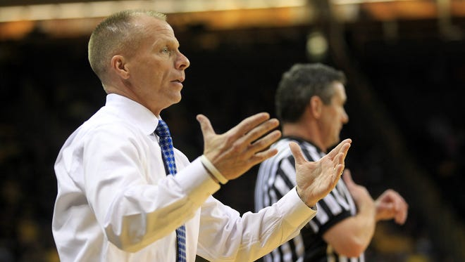 """North Florida head coach Matthew Driscoll questions a call during the Ospreys' game against Iowa at Carver-Hawkeye Arena on Monday. """"(The Hawkeyes), they get down when they miss a shot,"""" Driscoll said after the game."""