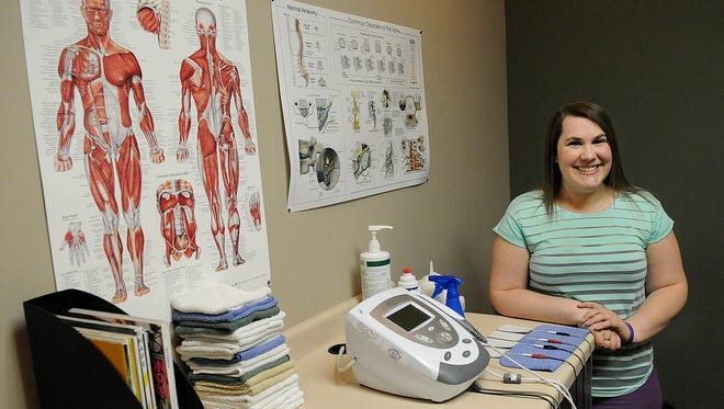 Kaija Undersander stands in one of the exam rooms March 23 at Chiropractic Plus in Waite Park.