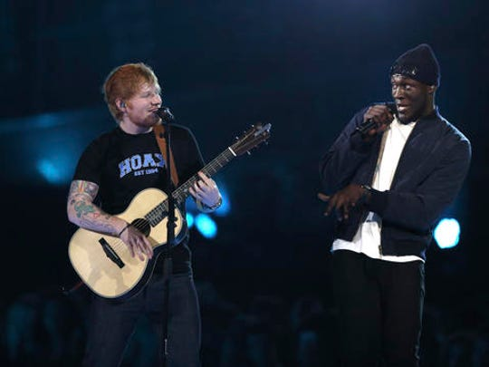Singers Ed Sheeran, left, and Stormzy perform on stage at the Brit Awards 2017 in London, Wednesday, Feb. 22, 2017.