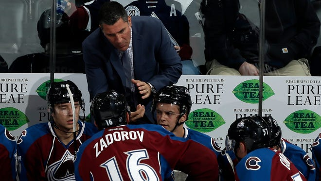 Colorado Avalanche head coach Jared Bednar, top, talks with his team during the first period of a preseason NHL hockey game against the Los Angeles Kings, Friday, Sept. 30, 2016, in Denver.