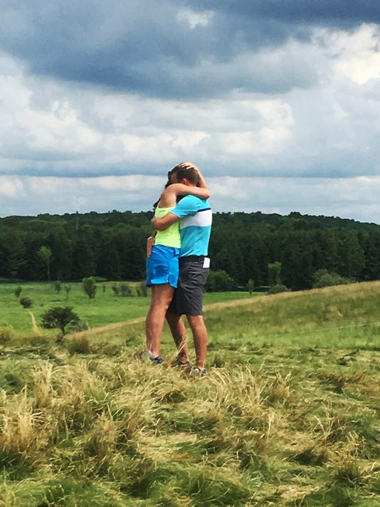 Malea Blise hugs Nick Rogness after he proposed to her during the third round of the U.S. Open golf tournament Saturday, June 17, 2017, at Erin Hills in Erin, Wis. (AP Photo/Doug Ferguson)