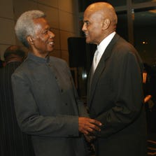 Filmmaker William Greaves, left, and talks with actor Harry Belafonte at the 80th anniversary celebration of Harlem's Schomburg Center at Jazz at Lincoln Center in New York on Oct. 6, 2006.