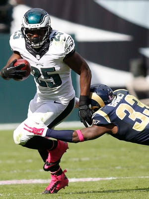 Eagles running back LeSean McCoy runs for a short gain on Sunday as Rams cornerback E.J. Gaines tries to bring him down.