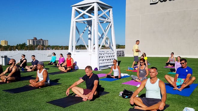 The Asbury offers yoga on their rooftop, the Baronet.