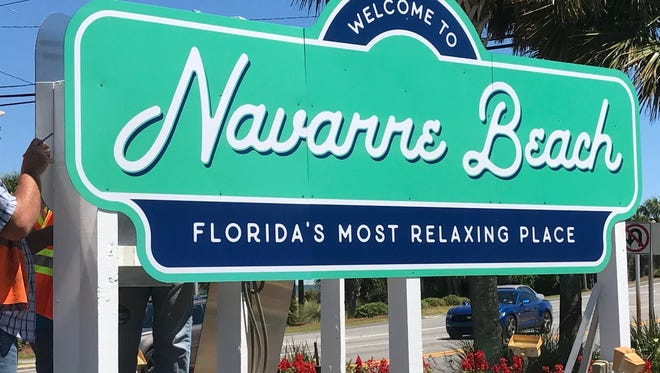 """A temporary """"Welcome to Navarre Beach"""" sign is erected near the entrance to the Navarre Beach Causeway on Thursday, May 25, 2017. Santa Rosa County Commissioner Rob Williamson, who represents the Navarre area, later removed the sign after receiving complaints from area residents"""