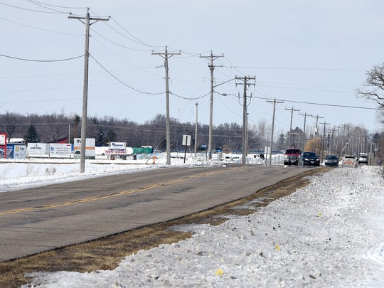 Traffic moves along Pinecone Road near the new high school construction site Wednesday, April 4, in Sartell.