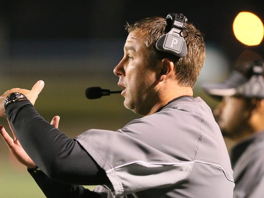 New Hope head coach Kris Pickle signals a play to his